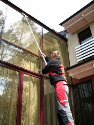 Washing of windows, display windows and glass walls